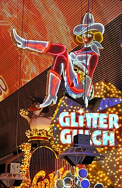 Vicky, famous cowgirl figure on a neon sign in old Las Vegas, Glitter Gulch Casino Hotel, Fremont Street Experience, downtown Las Vegas, Nevada, United States of America, USA, PublicGround