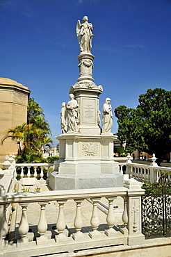 Statue of an angel on one of the monumental tombs, Colon Cemetery, Cementerio Cristobal Colon, named after Christopher Columbus, Havana, Cuba, Caribbean