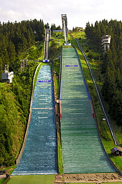 Normal and large ski flying hill, covered with jump mats, Am Kanzlersgrund ski jump complex in summer, near Oberhof, Thuringia, Germany, Europe