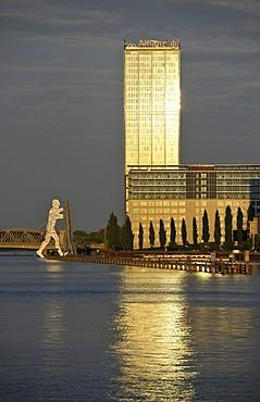 Molecule Man, a 30m high monumental work of art by sculptor Jonathan Borofsky, beside Eisenbruecke Bridge, Allianz SE Tower and Treptow-Towers, Friedrichshain-Kreuzberg, Berlin, Germany, Europe
