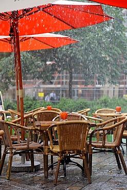Rain in an outdoor restaurant, Hackescher Markt, Mitte district, Berlin, Germany, Europe