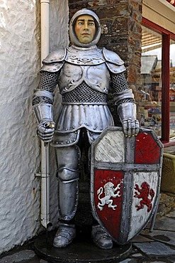 Life-size figure of King Arthur, Knight of the Round Table, in front of the Merlin Gifts & Confectionery shop, Fore Street, Tintagel, Cornwall, England, United Kingdom, Europe