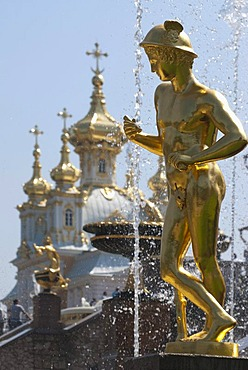 Golden statue of the Grand Cascade in front of onion domes, Peterhof Palace, St. Petersburg, Russia