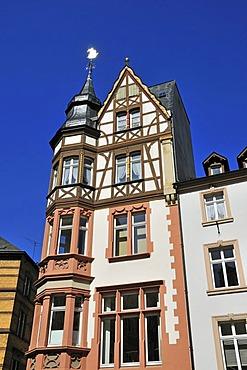 Half-timbered house with weathervane on the marketplace in Bernkastel-Kues, Rhineland-Palatinate, Germany, Europe