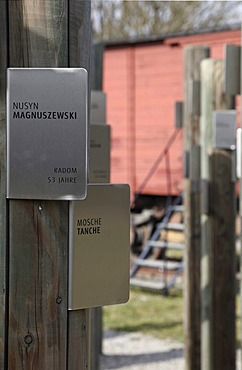 Posts with name tags of Jewish prisoners in front of a carriage used to transport the prisoners, memorial at Hessental Concentration Camp, Schwaebisch Hall, Baden-Wuerttemberg, Germany, Europe