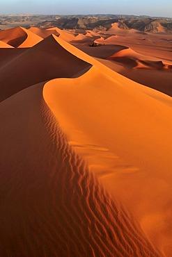 Red sanddune at Tin Merzouga, Acacus Mountains or Tadrart Acacus range, Tassili n'Ajjer National Park, Unesco World Heritage Site, Algeria, Sahara, North Africa