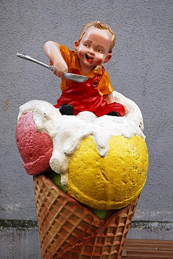 Advertising character from an ice cream parlor, a small child sitting in an ice cream cone, Wasserburg am Inn, Bavaria, Germany, Europe