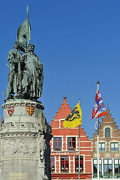 Statue of Jan Breydel and Pieter de Coninck, folk heroes, on the market square Grote Markt, in the historic centre of Bruges, Flanders, Belgium, Europe