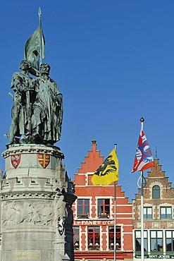 Statue of Jan Breydel and Pieter de Coninck, folk heroes, on the market square Grote Markt, in the historic centre of Bruges, Flanders, Belgium, Europe