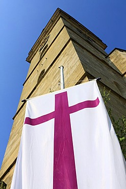 Protestant church flag on the market place in front of the spire of the protestant church of St. Peter and Paul, Oehringen, Hohenlohe, Baden-Wuerttemberg, Germany, Europe