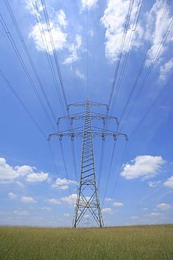 Power poles, transmission line, field, blue sky, Wipperfuerth, North Rhine-Westphalia, Germany, Europe