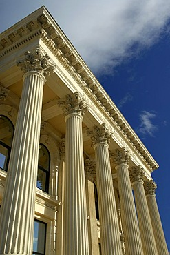 The facade of a typical limestone building with columns, in downtown Oamaru, South Island, New Zealand