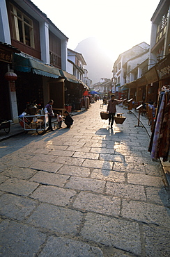 Street scene of cobblestone street, Guilin, Yangshou, Guangxi Province, China, Asia