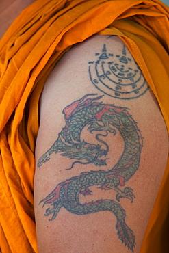 Monk with dragon tatoo on upper arm, Bangkok, Thailand, Southeast Asia, Asia