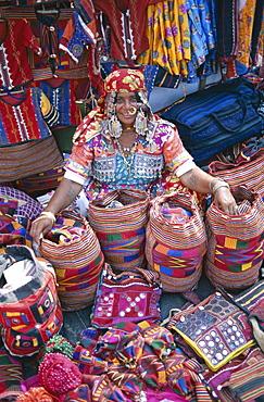 Gypsy vendor selling local crafts, Anjuna Market, Goa, India, Asia