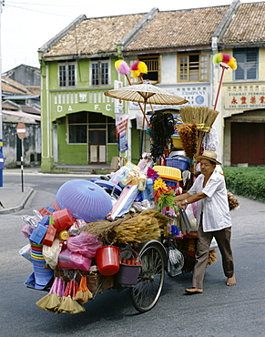 Street vendor selling household items, Penang, Malaysia, Southeast Asia, Asia