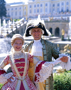 Couple dressed in period costume, Peterhof Palace (Petrodvorets Palace), St. Petersburg, Russia, Europe