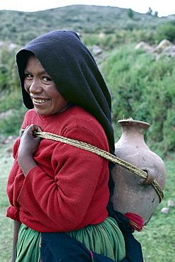 Woman with water jar, Taquile Island, Lake Titicaca, Peru, South America