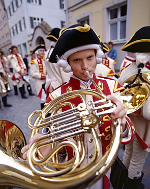 Young boy playing traditional horn, Childrens Festival (Kinderzeche), Dinkelsbuhl, Bavaria, Romantic Road (Romantische Strasse), Germany, Europe