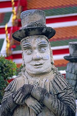 Statue depicting early European traveller, Wat Pho, Bangkok, Thailand, Southeast Asia, Asia