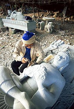 Sculptor carving Buddha statue near Khorat, Thailand, Southeast Asia, Asia