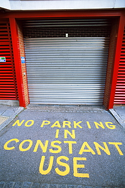 No Parking sign in front of garage entrance, London, England, United Kingdom, Europe