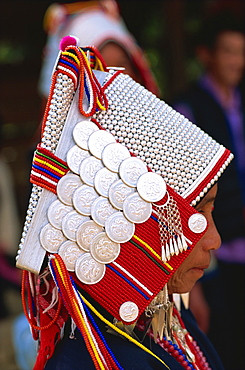 Akha hilltribe woman wearing traditional silver headpiece and costume, Golden Triangle, Chiang Rai, Thailand, Southeast Asia, Asia
