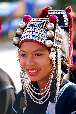 Akha hilltribe girl wearing traditional silver headpiece and costume, Chiang Rai, Golden Triangle, Thailand, Southeast Asia, Asia