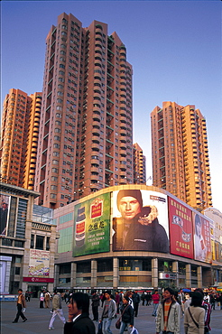 Shopping street and high rise apartments, Guangzhou, Guangdong Province, China, Asia