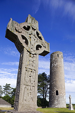 Celtic Cross and Round Tower, Clonmacnoise, County Offaly, Leinster, Republic of Ireland, Europe