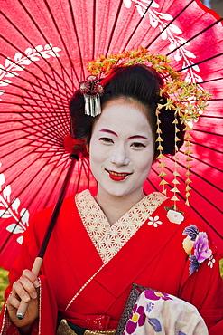 Portrait of Maiko (apprentice geisha) dressed in kimono, Gion, Kyoto, Japan, Asia