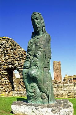 Cuthbert of Farne sculpture, Lindisfarne Priory, Holy Island, Northumbria, England, United Kingdom, Europe