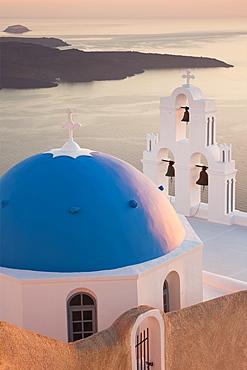 Church domes in evening sunlight, Santorini, Cyclades, Greek Islands, Greece, Europe