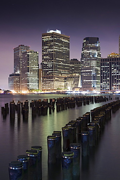 Downtown Manhattan skyline and the remains of an old pier at the base of the Brooklyn Bridge Park in New York, New York State, United States of America, North  America