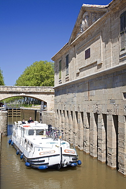 A barge on the Canal du Midi, UNESCO World Heritage Site, in spring, Languedoc-Roussillon, France, Europe.