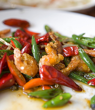 Colorful and spicy Sichuan cuisine shrimp dish uses both red and green chili peppers, Chongqing, Sichuan, China, Asia