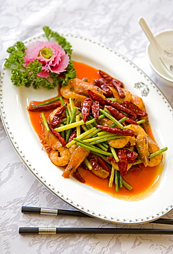 Colorful and spicy Sichuan cuisine dishes use both red and green chili peppers, eaten with chopsticks, Chengdu, Sichuan, China, Asia