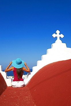 Tourist on roof of red church above the old town, Mykonos town, Chora, Mykonos, Cyclades, Greek Islands, Greece, Europe