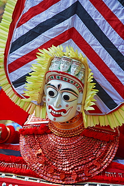 Man in costume representing a god at the Teyyam ceremony, near Kannur, Kerala, India, Asia