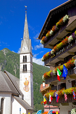 Church and hotel, Alleghe, Belluno Province, Italian Dolomites, Italy, Europe