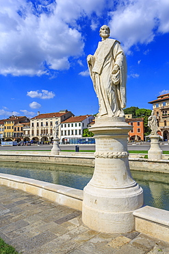 View of statues in Prato della Valle and colourful architecture visible in background, Padua, Veneto, Italy, Europe