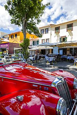 View of red vintage MG car in front of traditional Al Fresco restaurant in old town, Funchal, Madeira, Portugal, Europe