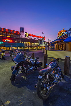 Motorbikes outside Fishermans Wharf cafes and restaurants at dusk, San Francisco, California, United States of America, North America