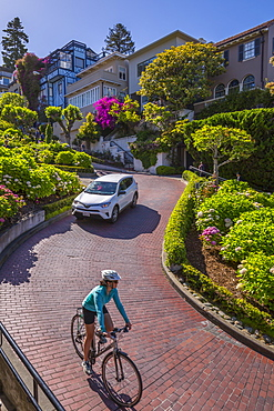 Car and cyclist on Lombard Street, San Francisco, California, United States of America, North America