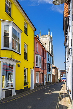 Cromer Parish Church of St. Peter and St. Paul and colourful houses on a summer day, Cromer, Norfolk, England, United Kingdom, Europe