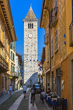 View of clock tower on Via Umberto l, cobbled street in Cannobio, Lake Maggiore, Piedmont, Italy, Europe