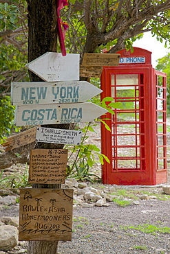 Red Telephone Box and signs at Mama Pasta's, Long Bay, Antigua, Leeward Islands, West Indies, Caribbean, Central America