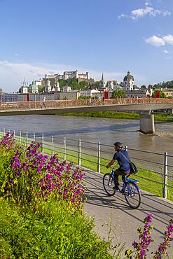 View of Hohensalzburg Castle and footbridge over Salzach River, UNESCO World Heritage Site, Salzburg, Austria, Europe