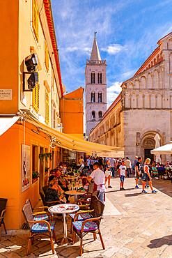 View of busy restaurant and Cathedral of St. Anastasia, Zadar, Zadar county, Dalmatia region, Croatia, Europe