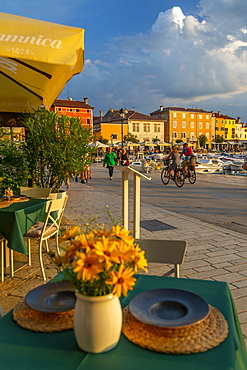 View of restaurant table set and Old Town buildings, Rovinj, Istria, Croatia, Adriatic, Europe
